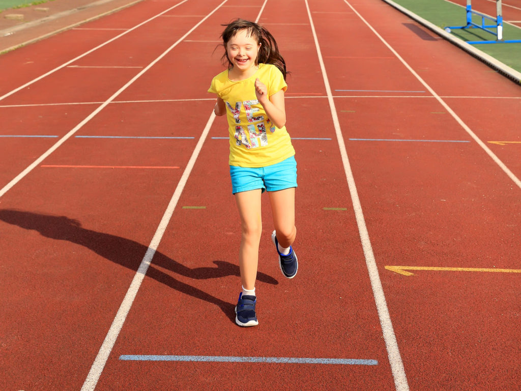 Girl running on a track.