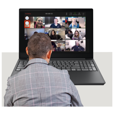 A man looks at an online meeting on a computer