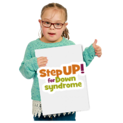 A young girl holding a sign saying Step UP