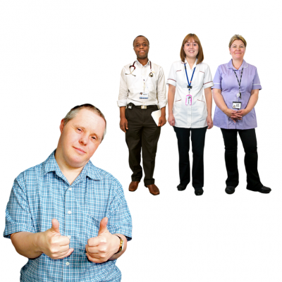 A man with thumbs up and a group pf health professionals