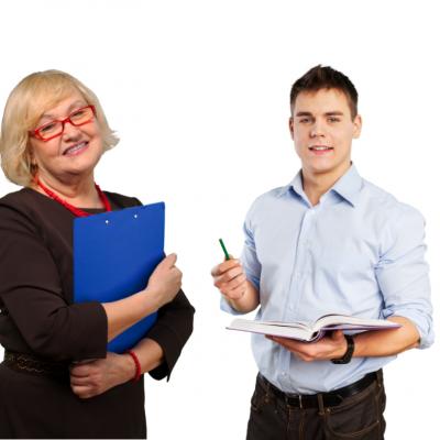 A male and a female teacher holding books