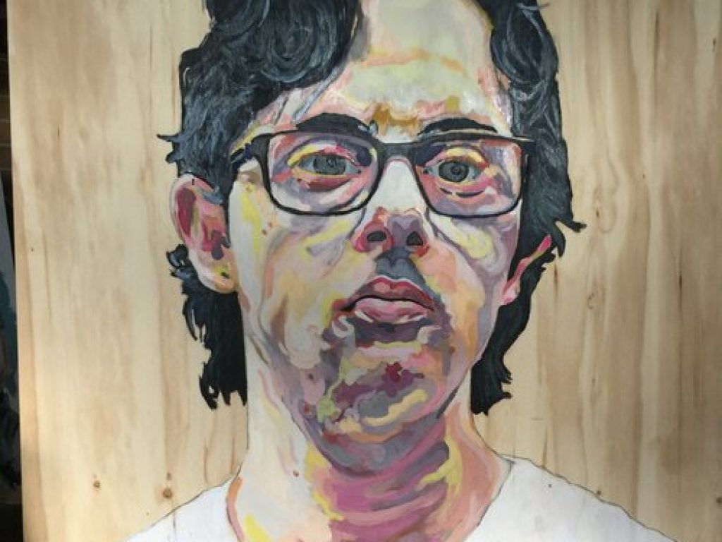 A finished painting of Nathan on wood.
