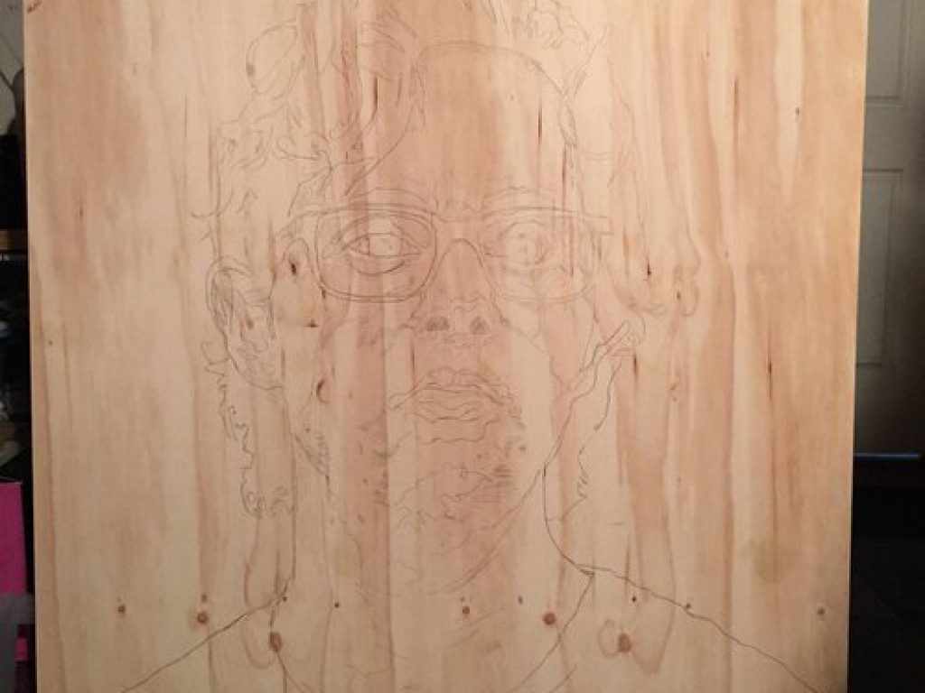 A drawing of Nathan on wood.