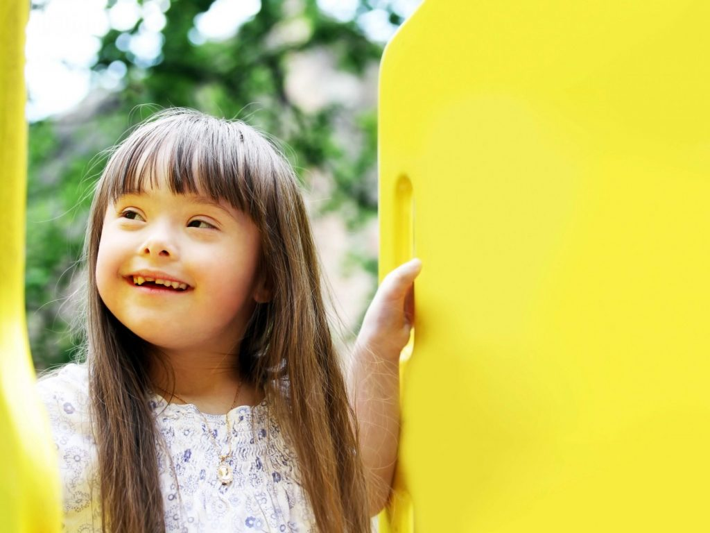 A girl in a yellow toy set.