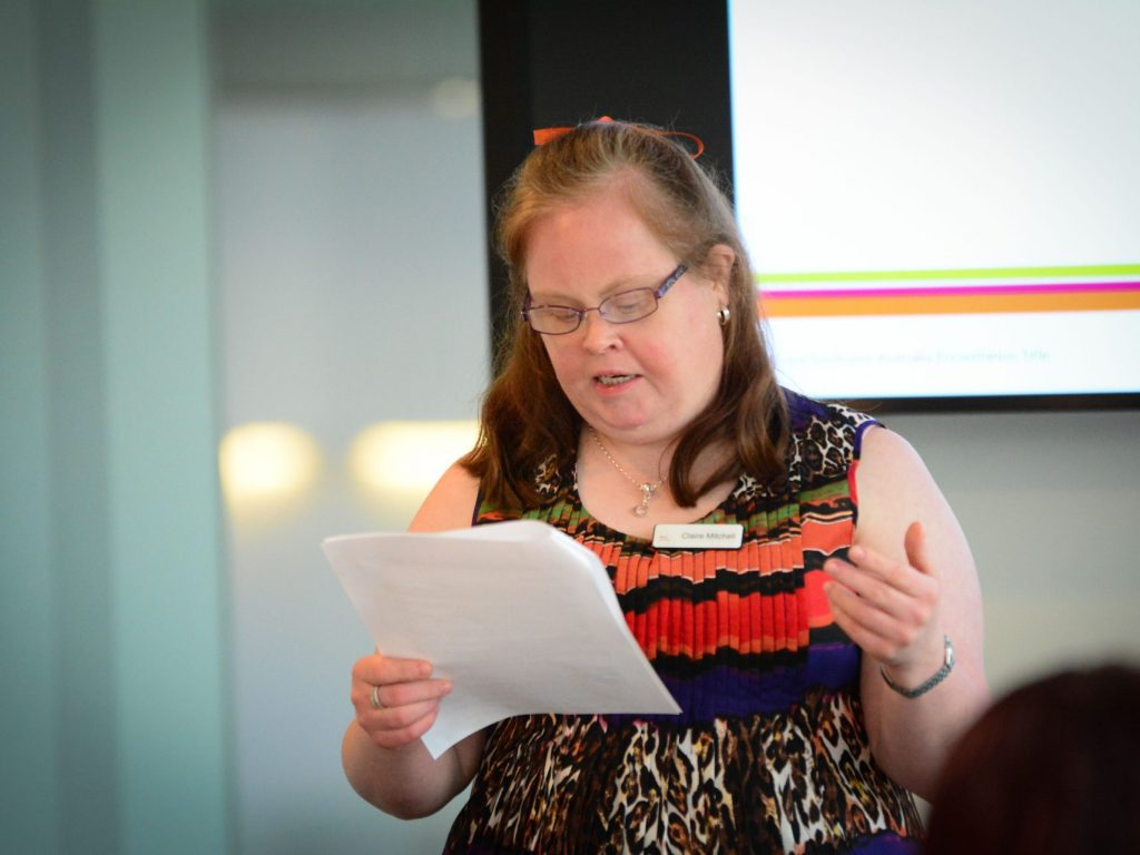 Woman with Down syndrome giving a talk