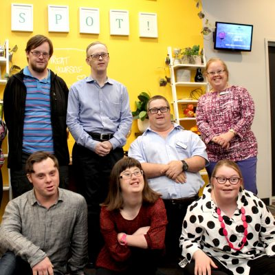 A group photo of DSAN members indoors.