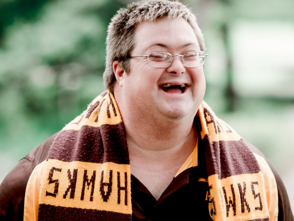 Andrew Domahidy wearing a hawks scarf