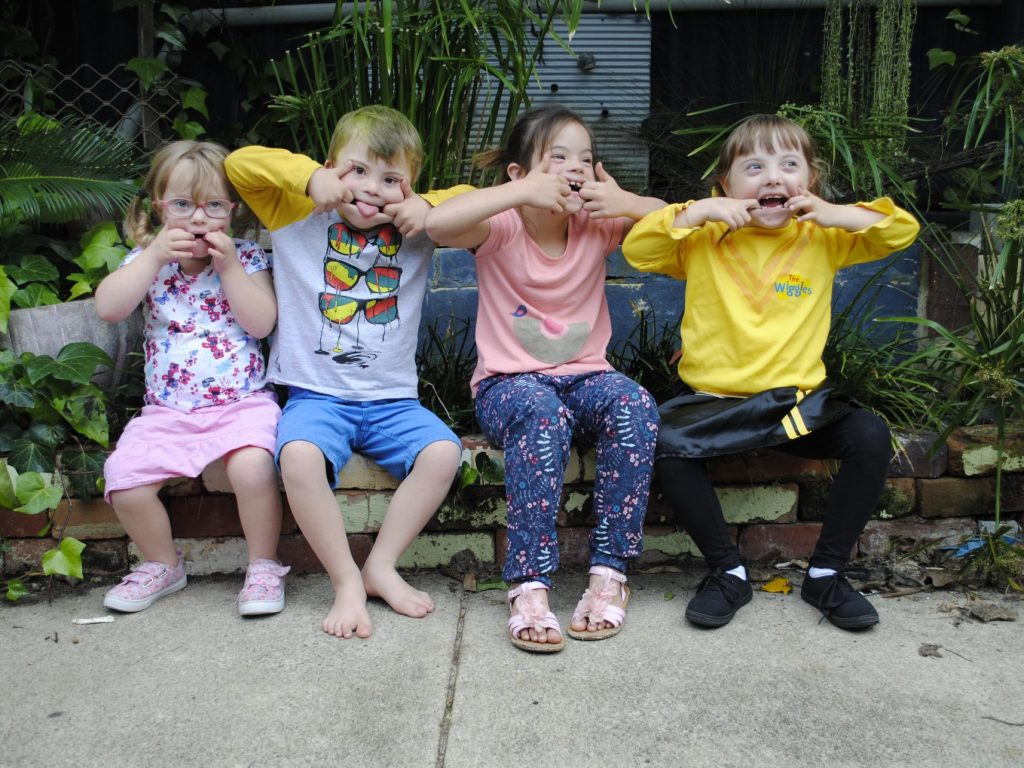 Four kids making faces