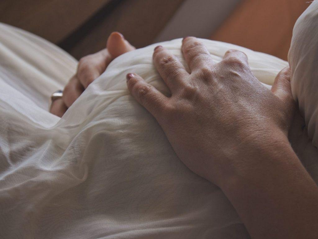 Baby bump under blanket