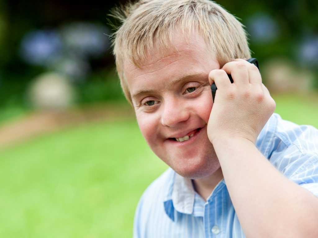 A smiling man having a phone call
