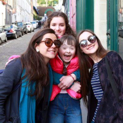 3 women and a girl smiling