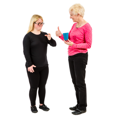 Two women stand talking
