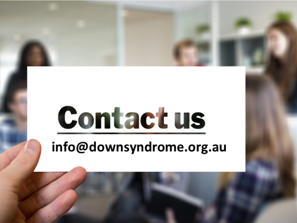 A sign says Contact us with an email address info at down syndrome.org.au