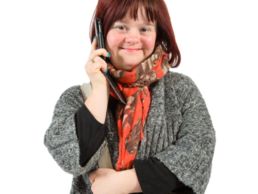 A woman talks on a telephone