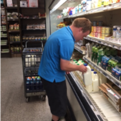 A man works in a grocery store