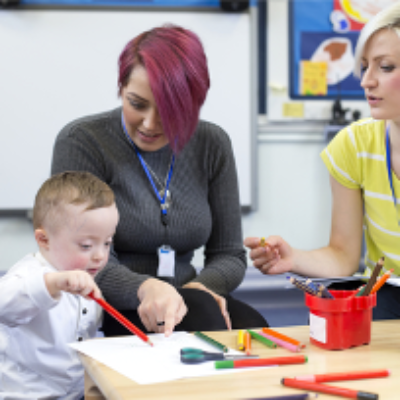 Teachers help a young child to learn