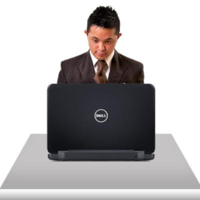 A man looks at a laptop computer