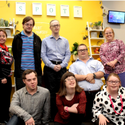 The Down syndrome Advisory Network - a group of people with Down syndrome stand together