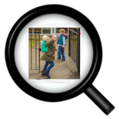 A magnifying glass over a picture of children at school