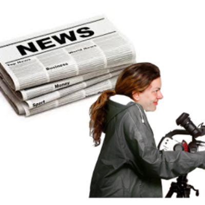 A person stands at a microphone and a picture of a newspaper