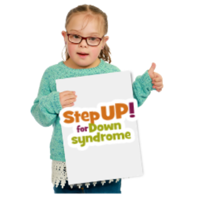 A young child holds a fundraising sign with the words StepUp for Down syndrome