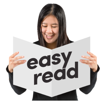 A woman holds a document with the words Easy Read