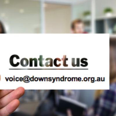 A hand holding a card with the email address voice@downsyndrome.org.au