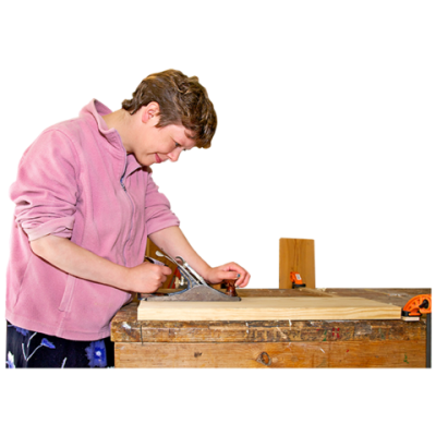 A young man does woodwork