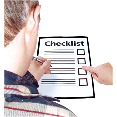 A man looks at a checklist document