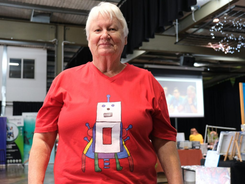 A woman in a red t shirt by Melissa Kirkman